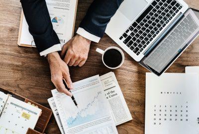Business person's desk showing a graph